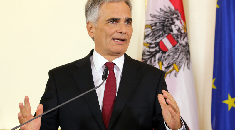 Austrian Chancellor Werner Faymann address the media during a news conference on asylum seekers at the federal chancellery in Vienna, Austria, Friday, July 31, 2015. Austria's federal government plans to change the constitution in attempts to end a standoff with provincial leaders over finding housing for a massive influx of migrants. (AP Photo/Ronald Zak)