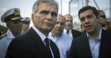 Austrian Chancellor Werner Faymann , left, and Greek Prime Minister Alexis Tsipras, right, visit the Moria camp in Lesbos island , Greece, on Tuesday, Oct. 6, 2015. The Austrian Chancellor and the Greek premier visited Lesbos island Tuesday to view first-hand the impact of the refugee crisis and tour facilities set up to handle the thousands of people who arrive daily.(AP Photo/Santi Palacios)