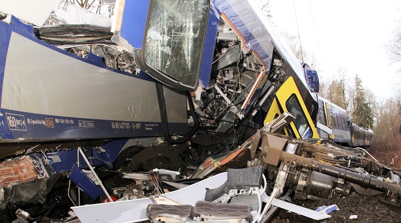 The axis sits separated from the carriage at the site of a train accident near Bad Aibling,Germany, Tuesday, Feb. 9,  2016.  Several people where killed after two trains collided head-on. (Josef Reissner/dpa via AP)