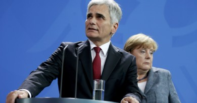 File photo of Austrian Chancellor Werner Faymann and German Chancellor Angela Merkel (R) reacting during a news conference at the Chancellery in Berlin, Germany September 15, 2015. In September, the leaders of Austria and Germany took one of the most pivotal decisions of Europe's refugee crisis, throwing open their borders to tens of thousands of migrants piling up in Hungary. Nearly half a year on, however, the display of unity over the Sept. 5-6 weekend is a distant memory. In a sign of how deep Europe's divisions over refugees have become, Berlin and Vienna snipe at each other almost daily. REUTERS/Hannibal Hanschke/Files