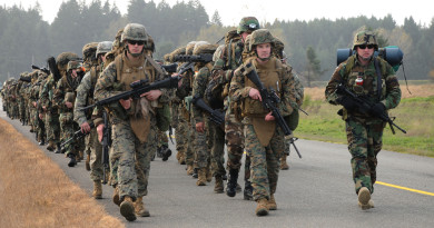 101025-N-2143T-002  JOINT BASE LEWIS-MCCHORD, Wash. (Oct. 25, 2010) Sailors and Marines assigned to Marine Corps Security Force Battalion carry their battle gear on a seven-mile march as part of combined force-on-force training. More than 150 Sailors and Marines took part in the weeklong field training exercise, which focused on military operations in urban terrain, urban patrolling, building assaults and room clearing. (U.S. Navy photo by Mass Communication Specialist 2nd Class Maebel Y. Tinoko/Released)