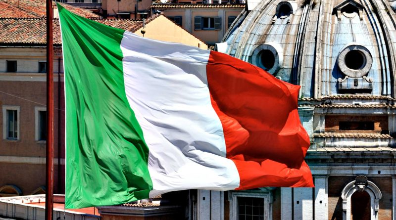 """Italy Adopts $30 Billion of Cuts in EU Deficit Push...The Italian national flag flies above Piazza Venezia in Rome, Italy, on Wednesday, May 26, 2010. Prime Minister Silvio Berlusconi said Italy's planned 24.9 billion euros ($30.4 billion) of budget cuts over the next two years are """"absolutely necessary"""" to defend the euro and protect Italy. Photographer: Victor Sokolowicz/Bloomberg"""